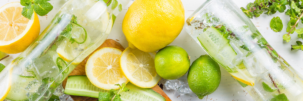 water, with lemons and limes