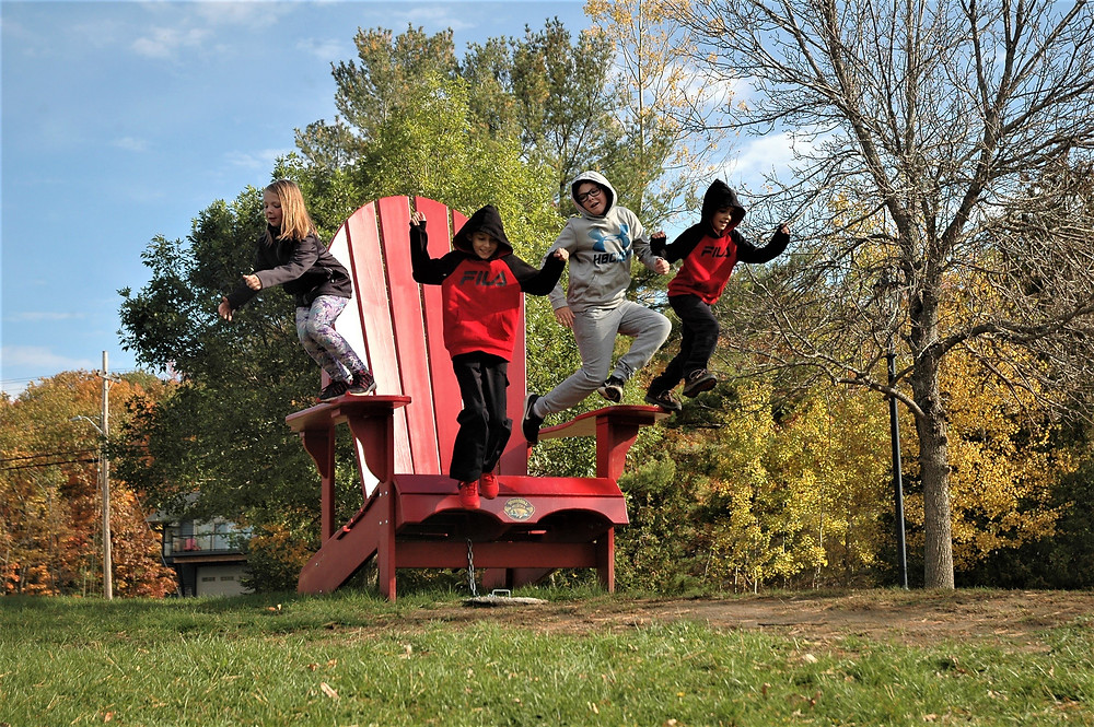 Kids playing on a large chair!