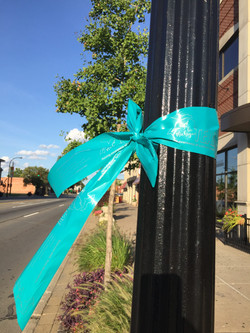Light pole with teal ribbon