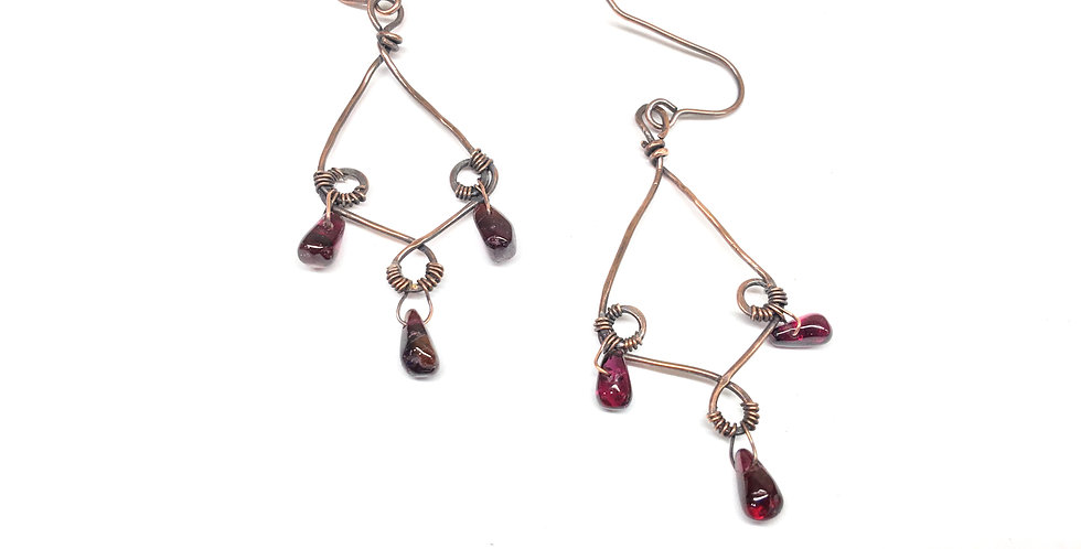 Garnets in Loopy Diamond Shapes