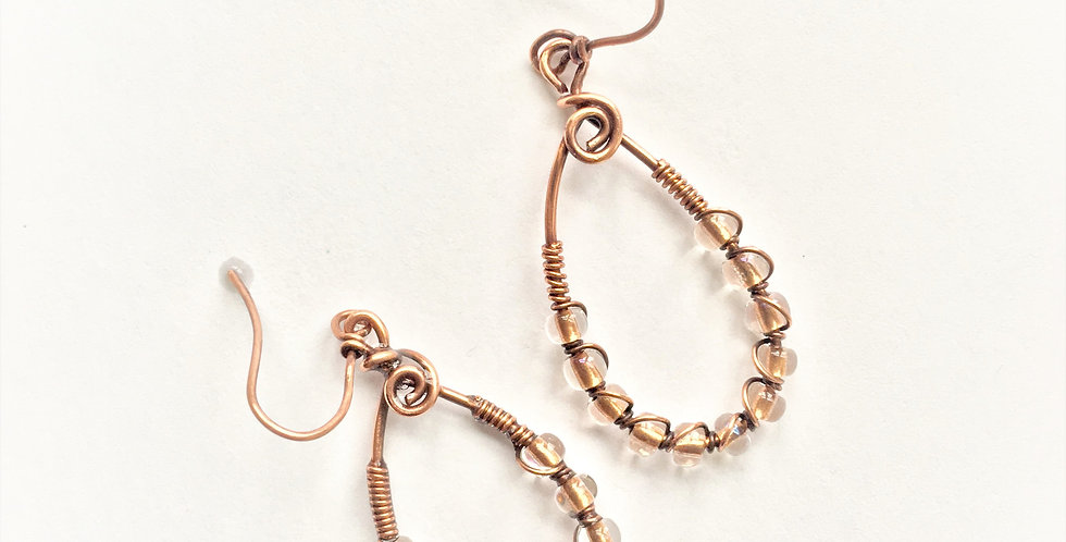 Glass Beads in Coiled Copper Loops