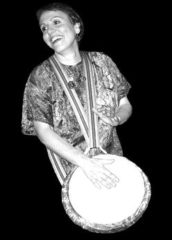 Mae Stoll on the Djembe, Austin hand drumming classes, Austin African drums