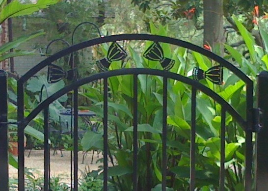 """Our """"Djembe Gate"""" leading to the drumming studio."""