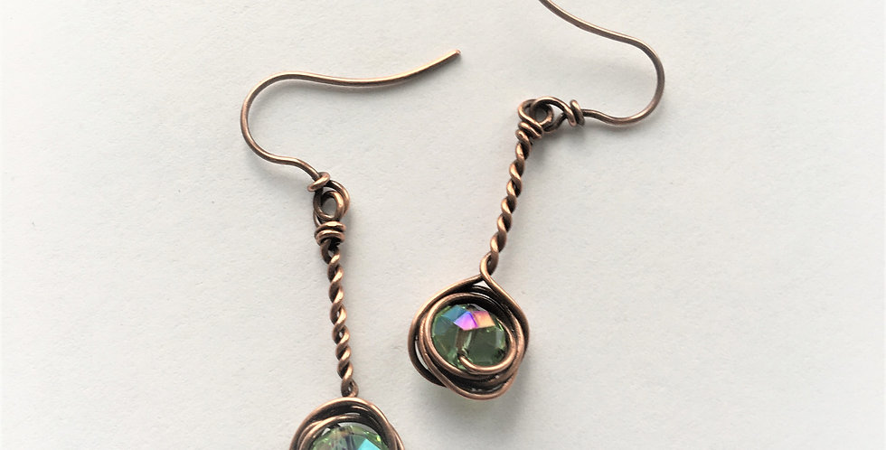 Faceted Glass in copper nest w/ stem