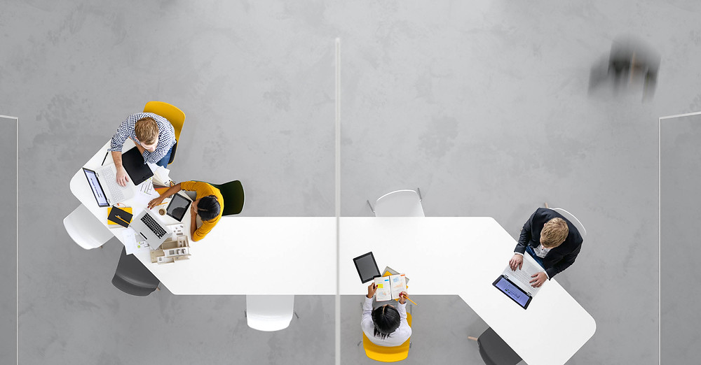 Birdseye view of a quirky table with colleagues working together
