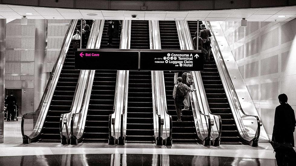 travel page escalator funny