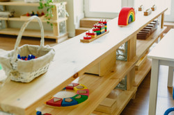 images of a montessori classroom with al
