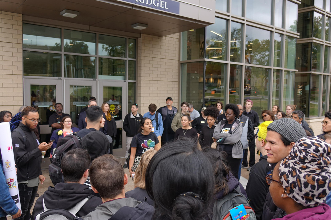Ayesha Vishani, Four Front co-chair, speaks at the solidarity walk Friday, October 19, 2018. Members of Four Front and the Legion of Black Collegians walked from the Gaines/Oldham Black Culture Center to the dedication of Bluford and Brooks halls.