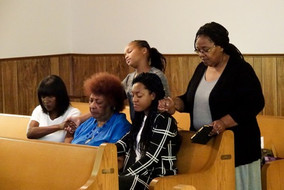 (Clockwise from top left:) Deija Wardlow, Twila Overton, Capri 'Ona Fountain, Ella Reese, and Sue Long, pray together at St. Paul Christian Methodist Episcopal Church in Mexico, Missouri, Sunday, Sept. 30, 2018. Though the women are not related, they connected while praying together as the rest of the congregation gathered at the altar during the service. African Americans report engaging in daily prayer more than other racial groups, according to Pew Research Center data.