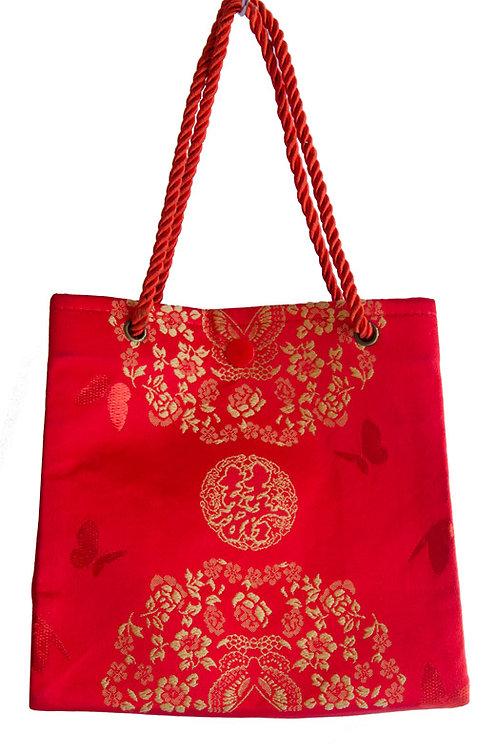 紅色絲綢手提袋。織繡精緻雙喜字樣