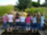 children bench learning corn maze