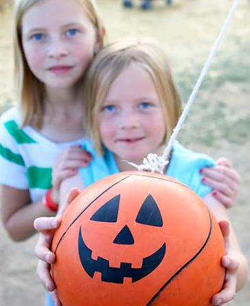 girls tetherball rope playing