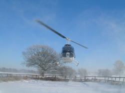 Bell 206 landing in the snow