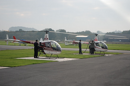 Helicopters being fuelled and pre flight checked before Flight