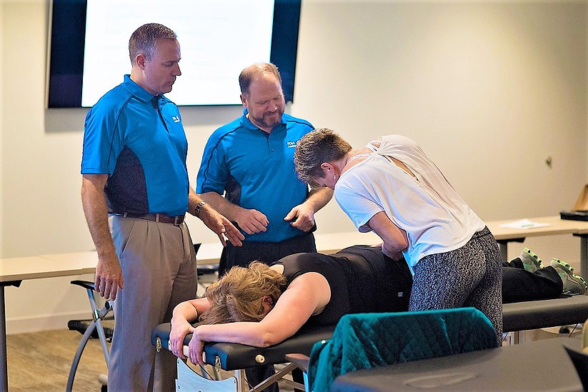 Matt Booth, PT, DPT, and Todd Capistrant, DO, teaching FDM manual therapy for the FDM Academy at NorthBay VacaValley Hospital