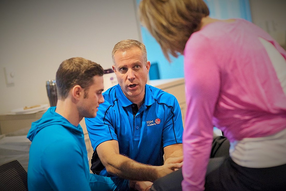 Matt Booth, PT, DPT, teaching FDM manual therapy for the FDM Academy