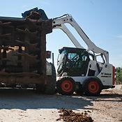 S590 Skid Steer Loader Root Grapple Load