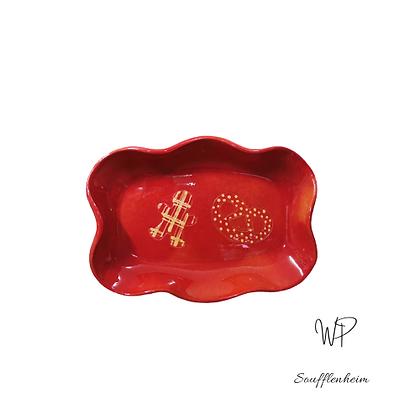 Ravier ondulé rouge décor biscuits.