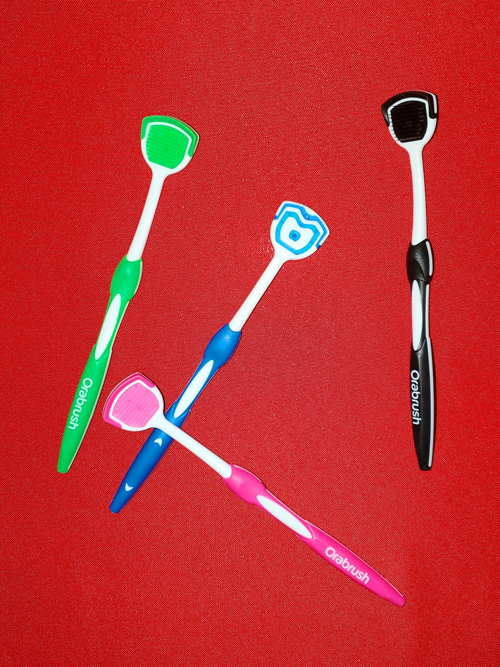 orabrush, tongue scraper, tongue brush, oral aid