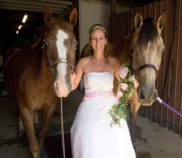 Bride posed with her two horses