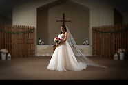 Bride posed on alter creative lighting