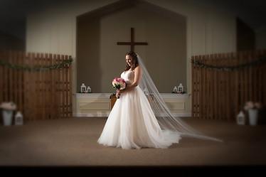 Bride posed on alter creative lighting