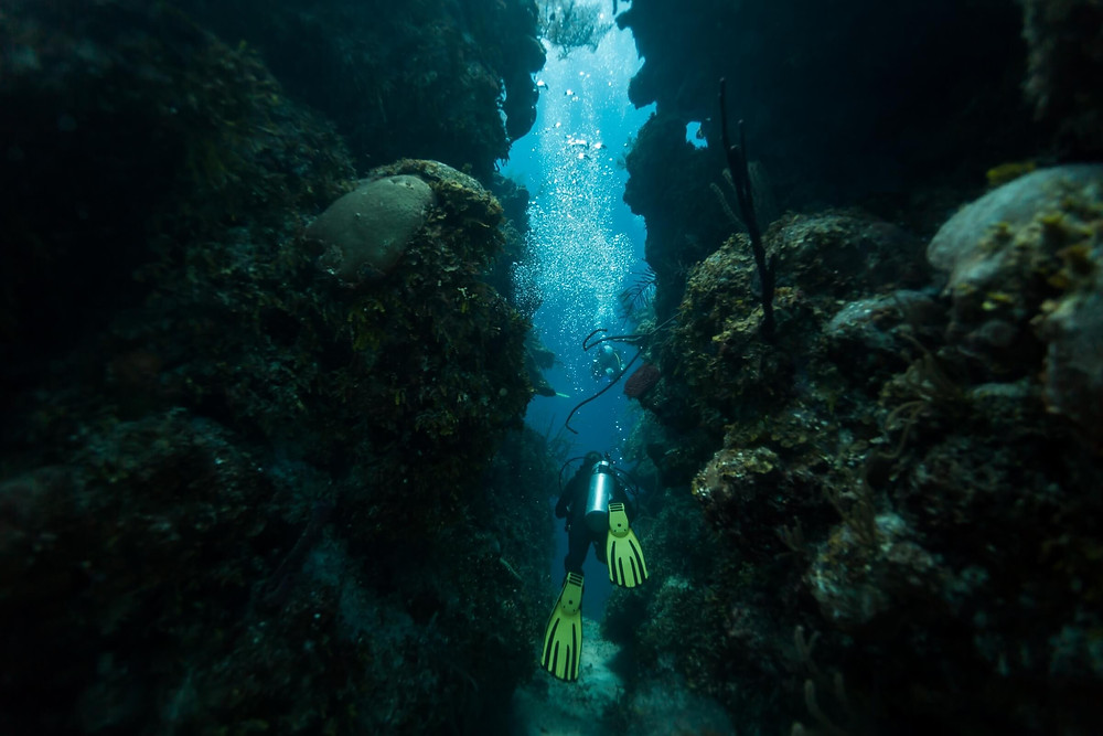 Scuba diving inside the caves in the Great Blue Hole in Belize.