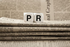 Abbreviation PR on newspapers background