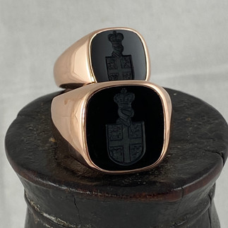 HIS AND HERS ONYX COAT OF ARMS