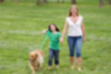 Mother And Daughter Walking The Dog.jpg