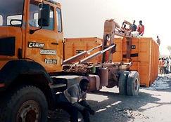 camion polybenne sur marché coton autogéré