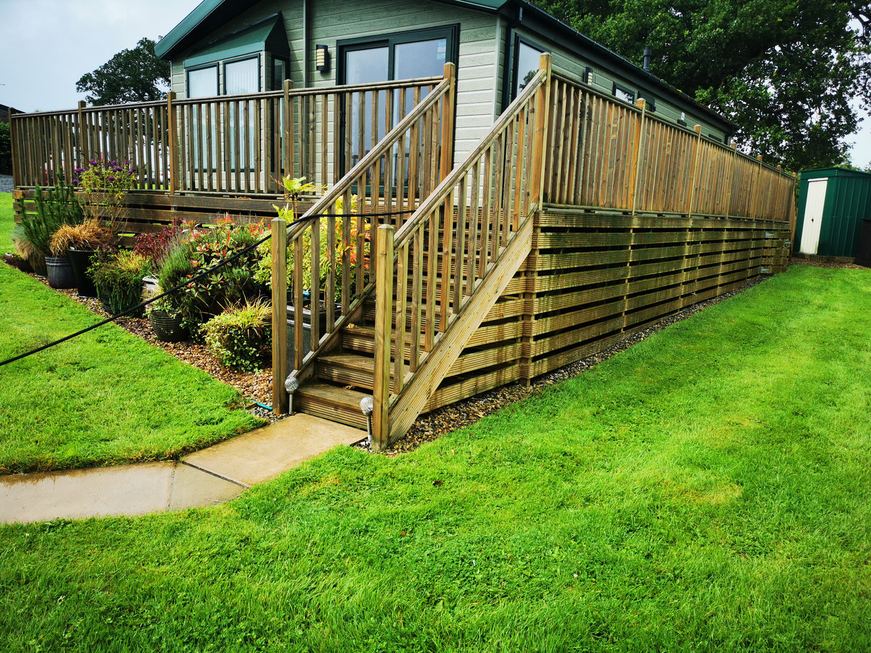 Decking Cleaning followed with oil treatment with optional stain