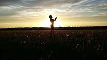 Boy's silhouette against the sunset