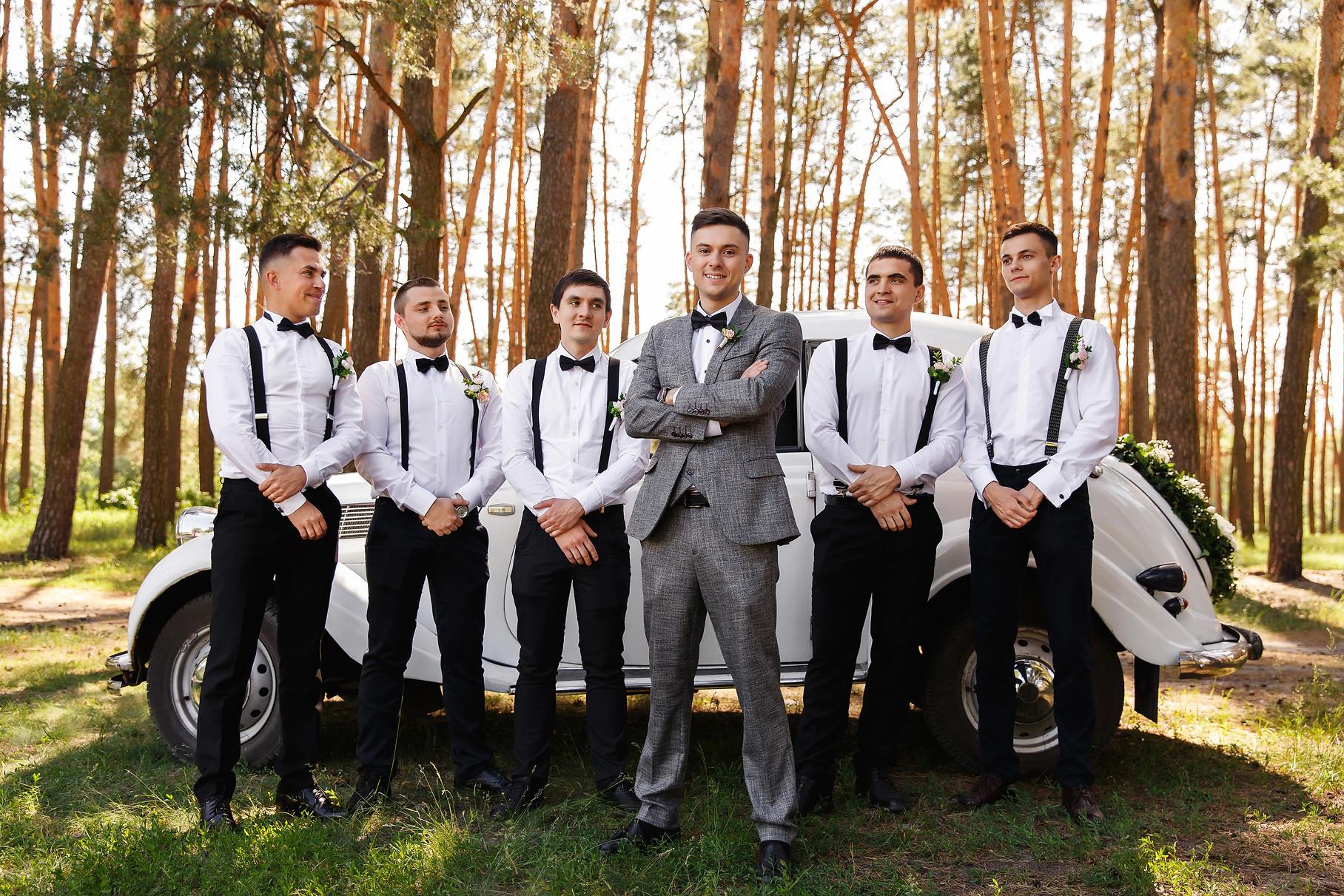 Group wedding photo of elegant groom in