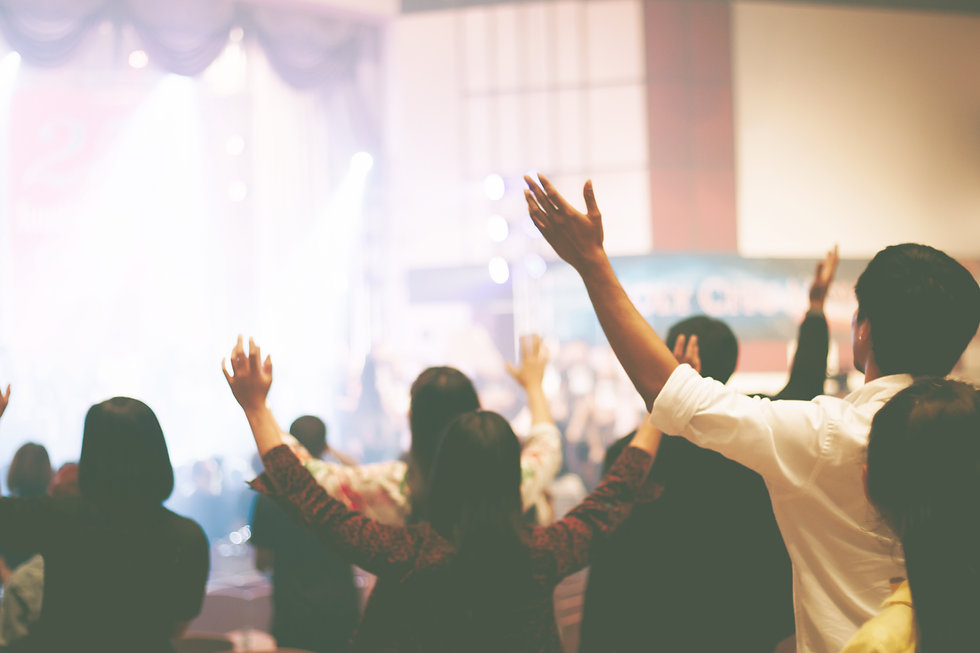 Christian worship with raised hand,music