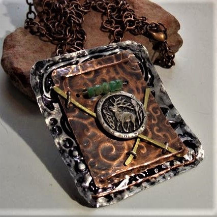 Wyoming-style, hand-forged elk with emeralds necklace