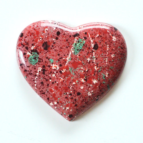Ruby choclate heart coloured with red, white and green cocoa butter. Made by Anastassia Chocolates