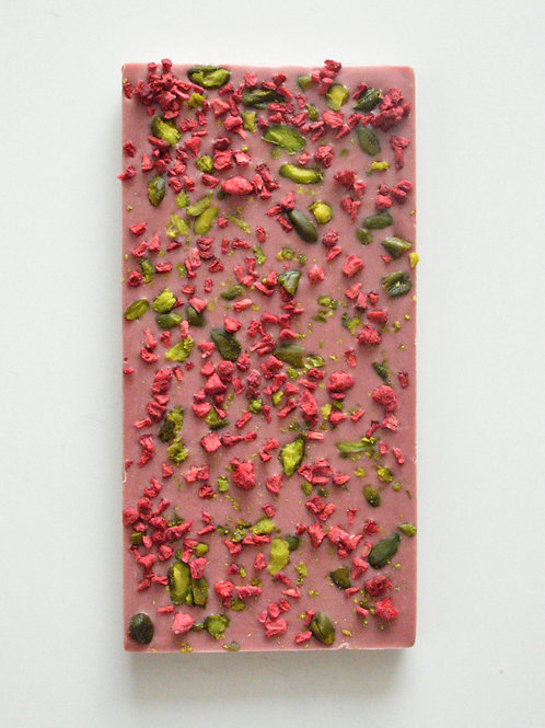 Pink, fruity, creamy ruby choclate bar with free dried rapberries pieces and pistachio made by Anastassia Chocolates