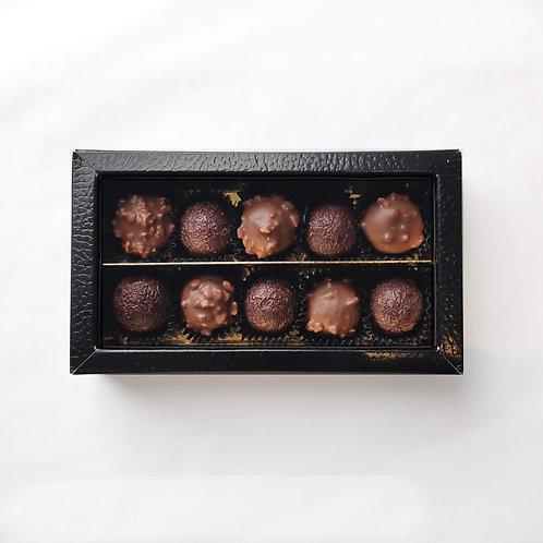 Sea salt caramel in dark chocolate, hazelnut caramel in milk chocolaten — £11