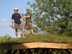 Chris and Tony feel the grass under thei