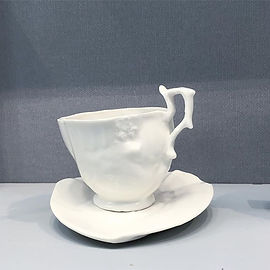 Minimus maximus cup and saucer at the British Craft Trade Fair, Brick Lane, London.jpg