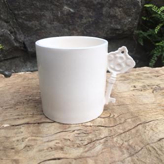Espresso cup with B key addition