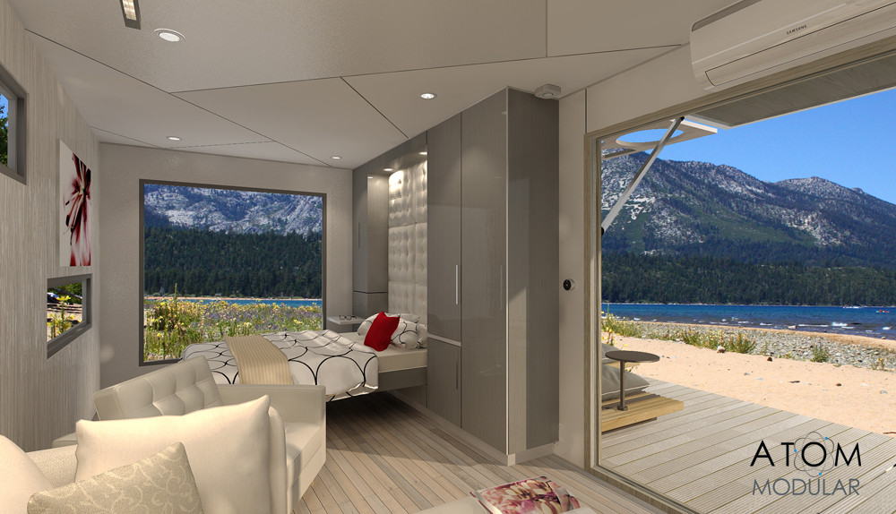 Multi-fold doors to the deck and an expansive windows achieve wide views, access and expanded living, giving the ATOM-1 Micro-House an airy-open feeling.