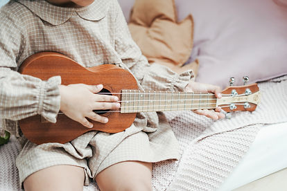 a-girl-holding-brown-ukulele-3662750.jpg