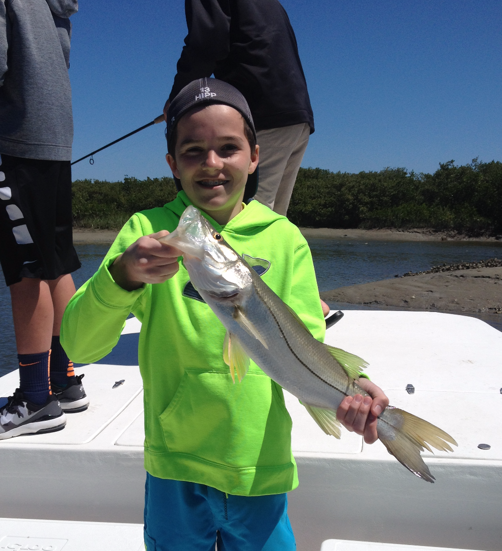 A happy angler and his first Snook.
