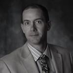 Mr. Corey Thompson, Director