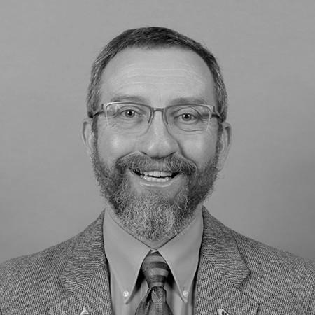 Dr. Mark Horner, Director