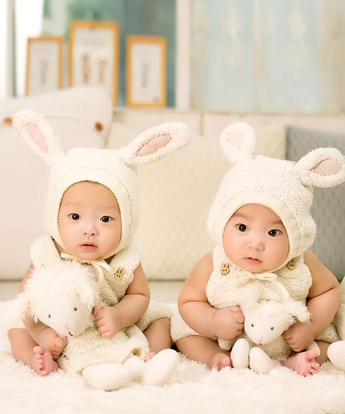 2-babies-wearing-white-headdress-white-h