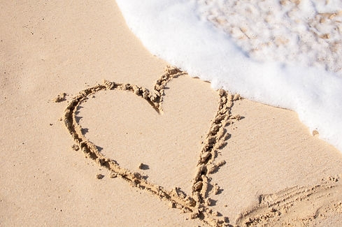 beige-sand-with-heart-engrave-697740.jpg