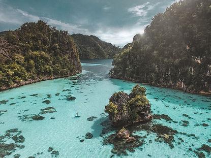 The wanderlovers calico jack luxury scubadive liveaboard raja ampat indonesia sorong west papua drone shot paddleboard